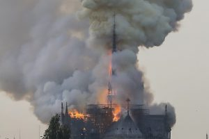 zzzzinte1Flames and smoke are seen billowing from the roof at Notre-Dame Cathedral in Paris on April 15, 2019. - A fire broke out at the landmark Notre-Dame Cathedral in central Paris, potentially involving renovation works being carried out at the site, the fire service said. (Photo by FRANCOIS GUILLOT / AFP)zzzz