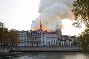 zzzzinte1Seen from across the Seine River, smoke and flames rise during a fire at the landmark Notre-Dame Cathedral in central Paris on April 15, 2019, potentially involving renovation works being carried out at the site, the fire service said. (Photo by FRANCOIS GUILLOT / AFP)zzzz