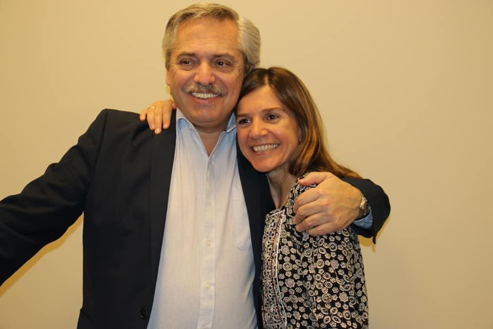 Raverta junto a Alberto Fernández.
